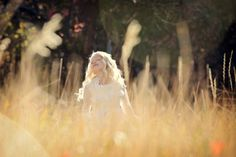 www.frostedproductions.com | #utah #child #photographer #white #lace #dress #eight #year #old #girl #natural #light #tall #grass #field