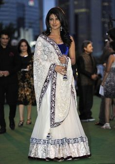Priyanka in her Manish Malhotra lahenga saree. I LOVE the blue velvet blouse. Must look into getting myself some of those.