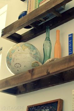 Wood and Glass Floating Shelves:: When we get a new house that has some work space I am SO going to ask for a saw for Christmas so I can start making projects like these!