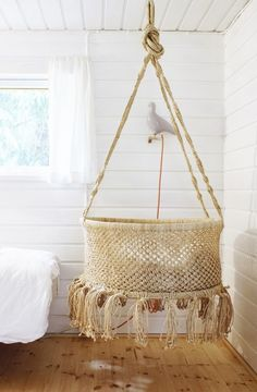 hanging bed/hanging crib? this would be great to naturally rock the baby back to sleep. just to figure out a way to hang one next to the bed... (via Varpunen: Perheen pienimmälle)