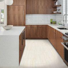 Beige, light tile-look flooring. Pergo Extreme Tile in Faint Maple
