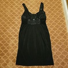 HOLIDAY♢ LITTLE BLACK DRESS MAGGY LONDON LITTLE BLACK DRESS  SIZE 8 TOP IS EMBELLISHED WITH BLACK SEQUINS  MATERIAL 95?POLYESTER 5 ? SPANDEX  TOP IS LINED PERFECT LITTLE BLACK DRESS TO HAVE IN YOUR CLOSET! Worn once / great condition Maggy London Dresses Mini