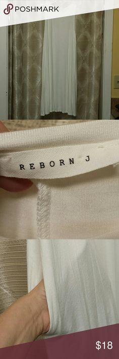 """NWOT Reborn J Sleeveless off white dress various Beautiful off white sleeveless dress, has pockets, flowy hem, beautiful weight hangs nicely Medium: length 36"""" pit to pit 18"""" 1XL: length 37"""" pit to pit 21"""" 2XL: length 37"""" pit to pit 22.5 """" Measurements are approximate Reborn J Dresses"""