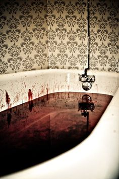 Fake blood in bathtub. Great for guest bathroom during a party.