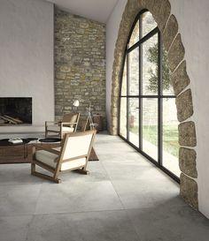 Salón con chimenea. Pavimento porcelánico de gran formato (100 x 100 cm.). Imagen 3D fotorrealista. actua.es