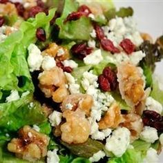 A yummy, easy salad with candied walnuts, cranberries, Gorgonzola cheese, mixed greens, and a raspberry vinaigrette. It's always a big hit and is requested by my friends and family constantly!