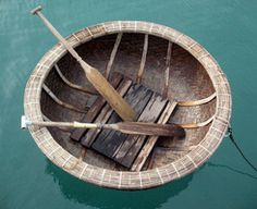 This is a coracle...a small round boat used on rivers in Wales and other places in Britain.