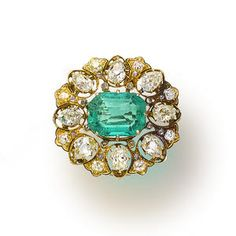 An antique emerald and diamond brooch, circa 1900