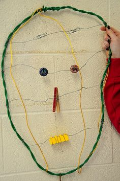 Wire sculpture inspired by Calder. Note use of paper clips, buttons and clothespin in scupture.