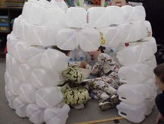 How to build a milk-bottle igloo - this would make a cute classroom display during the winter months or to feature in a study of Alaska, Antartica, etc.