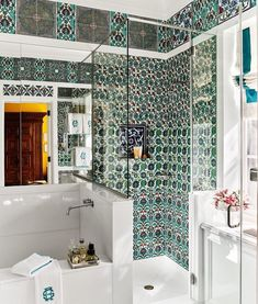 Antique Iznik tiles breath life into the master bathroom of author Andrew Solomon's NYC townhouse, designed by @robertcouturier58; photo by @thefacinator