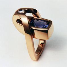 "Tanzanite Ring with Diamond: Rings by Wesley Harris MFA. Price: , Size:1 1/4"" high, 1"" long, Materials: 18 k. Yellow Gold, Tanzanite, Diamond"