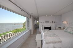 Pretty Panorama...........The home boasts six bedrooms, many of which have wall-to-wall windows with water views.