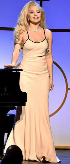 2cb44fa9bb36 Lady Gaga performing at Producers Guild Of America Awards 2016   Gaga  looked gorgeous in a plain nude dress with a diamond necklace and dangling  earrings.
