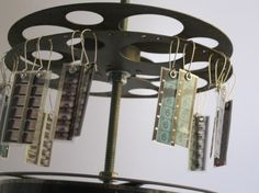 I really don't want the earrings, but I like the film reel stand. Would be neat as art piece with actual film hanging.