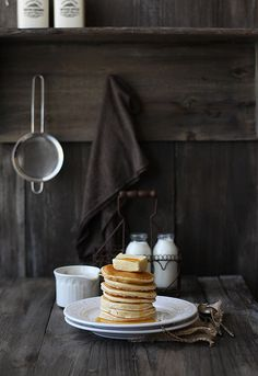 Pancakes.  Food staging / photography.  (That's one heck of a pile of butter)!
