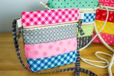 How cute are these zipper totes? The size is perfect for carrying your phone and wallet. But I must admit that as soon as I had sewn the first one for myself, my 8 year old daughter Cadie took it for herself! I had to make a couple more so that every girl in the house could have one.
