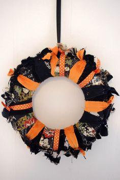 Couronne en tissu noir et orange : Décorations murales par abracadabroc