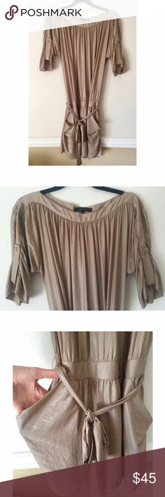 BCBG Max Azria Dress This super stylish Dress \ Tunic has a slouchy fit, hanging pockets, and a belt that ties around your hips. The fabric is gold/bronze with a shimmer. High quality, like new. Will fit both a medium and a large ✨ BCBGMaxAzria Dresses