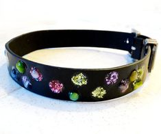 Leather dog collars are so expensive, but my beasts like to have something nice to wear. Since someone in my house always seems to be wearing out a belt, I thought I would try some reuse and make my own collars. This design uses epoxy to make dog proof faux jewels for decoration.