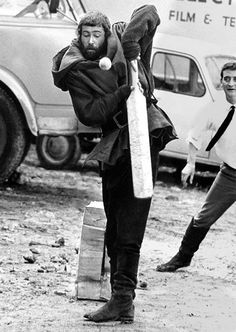Peter O'Toole playing cricket, dressed as King Henry II, on the set of The Lion in Winter