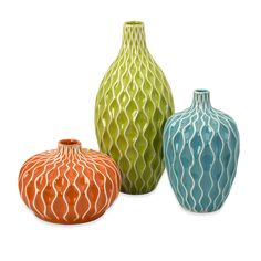 My living room might need the orange and green vases. $68.99 for three; free shipping