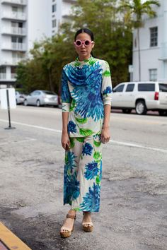 Would never wear this outfit but love her fearlessness and the clash of the pink sunnies and print - Street Style