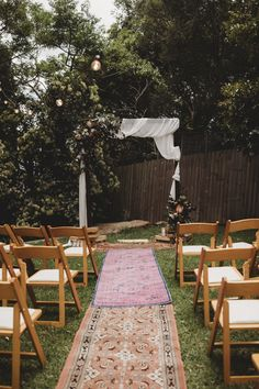 How sweet is this boho bride aisle? Get the look by pairing colourful runner rugs with simple flowers and our Wooden Padded Chairs. Boho Bride, Boho Wedding, Rustic Wedding, Outdoor Wedding Reception, Wedding Ceremony, Wooden Folding Chairs, Paper Daisy, Party Hire, Outdoor Tables