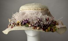 1908-1912 White beaver felt Gibson girl hat with lavender plumes and lavender silk ribbon with tiny flowers. The brim has a very slight oval shape. The silk of the ribbon is starting to split. A garla