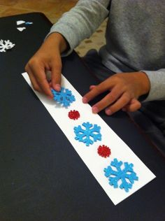 work on fine motor skills and making patterns to create a holiday bookmark