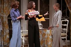 Blue jeaned Mary Richards, Totally Boho Chic Rhoda Morgenstern wearing the incredible crocheted, multi-colored, pieced-together, bolero vest w/ long flowing wide bell bottoms.  Drop the sign, girl, LOVE the vest!  Tailored Phyllis standing by.