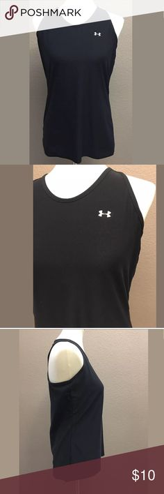 """Woman's Under Armour Heat Gear Tank Top, Size M Under Armour Black heat gear tank top size medium in good preowned condition  95% polyester and 5% elastane  Bust 34"""" Length 25"""" Arrives clean and ready for wear from a smoke free environment Under Armour Tops Tank Tops"""