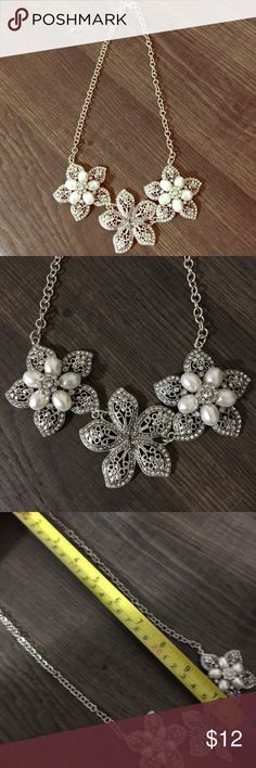 Silver Chain Three Flower Decor Necklace NWOT. Three silver metal flowers with rhinestone and pearl decor. Perfect for casual to dressy occasions.                              ❕TOP RATED SELLER❕                📦 FAST SHIPPING‼️📦                💕Quick Responses!💕                👌🏼Bundle to save 10%! Jewelry Necklaces