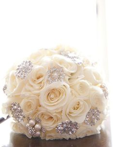 10 Wedding Bling Ideas: A simple bouquet of all white peonies or roses becomes a focal point when you add crystals and pearls. Photo by Dawn Joseph Photography