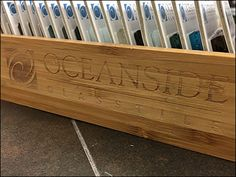 """Oceanside """"fire brands"""" its logo and branding onto the front and sides of this compact natural Wood Tray for Glass… Retail Merchandising, Wood Tray, Brand It, Bamboo Cutting Board, Trays, Natural Wood, Logo Branding, Fire, Hot"""
