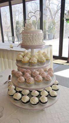Wedding cupcake tower-really like the small wedding cake on top