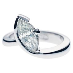 MARQUISE DIAMOND RING IN SWIRLING BAND | Stephen Dibb Jewellery