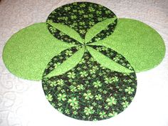 I wonder how hard can it be to cut circles? Because my straight lines always seem to have some curve to them :) St Patrick's Day Green Clover Table Top Quilt Runner @KeriQuilts
