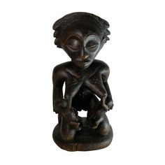 Carved wooden fertility statue - Ivory Coast