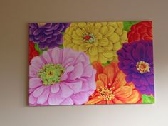 Zinnias by Peter Evans.  This is a 2x3 foot canvas using acrylic paint.  Bold, colorful and stunningly gorgeous!