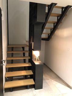 Staircase metal wood bookcase raw steel waxed designed made and . Staircase Interior Design, Spiral Stairs Design, Home Stairs Design, Home Interior Design, Staircase Metal, House Staircase, Modern Staircase, Stone House Plans, 3 Storey House Design