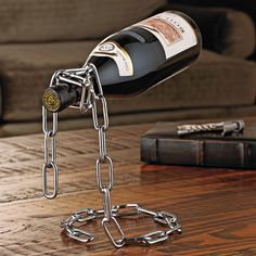Chain links are strong enough to support any wine or liquor bottle.Can hold 1 bottle Material / Ingredients Metal Dimensions / Weight X X DESIGNER/ BRAND NAME HitPlay Welding Art Projects, Metal Art Projects, Metal Crafts, Diy Projects, Metal Welding, Welding Tools, Diy Welding, Welding Ideas, Welding Design