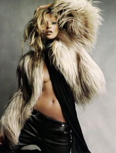 Looks like Kate is wearing a shaggy dog! | fur | kate moss | topless | leather | tan | dancing | movement |