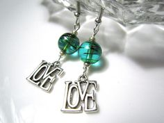 These dangly and dainty LOVE earrings are just perfect for Valentines Day.    Gorgeous turquoise glass confetti beads have swirls of colour -