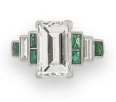 An art deco diamond and emerald ring, circa 1925 The rectangular step-cut…