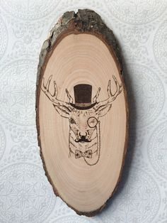 Hipster Deer with a mustache wood burned art. Pyrography basswood tree slice wall decor. Hand created by Timberlee