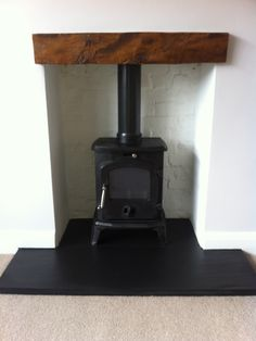 YES: white fireplace, black slate tiles, small cast iron woodstove Slate Hearth, Black Fireplace, Texas Homes, Just In Case, Slate Tiles, Hearths, Home Appliances, Studio Design, Stoves