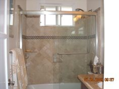 Small Tuscan Bathroom, but needs dark metals not silver, brone??? This is the shower/tubThere are sliding glass doors and Authentic looking tile.  duplicate tile around sink area