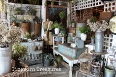 Check out our new French Garden Themed Window Vignette at our shop – Featuring garden finds, flowers, rusty bird cages, real dried French lavender, baskets, galvanized containers, bird nests, lanterns, topiaries, & more. Store retail display. Spring and summer decorating. Shop inspiration.