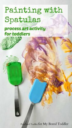 painting with spatulas process art for toddlers. A fun painting activity for toddlers and preschoolers. Great for messy play!